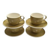Set of 4 Russel Wright Harkerware Cups and Saucers in the White Clover Pattern in Golden Spice Color