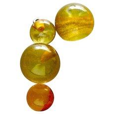 Four Vintage Applejuice Prystal Bakelite Buttons