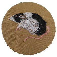 Beautifully Embroidered Linen Pinwheel Featuring A Rat