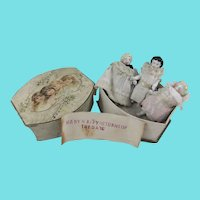 3 Miniature Frozen Charlottes Housed in Antique Rowntree's Cocoa Box