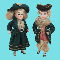 Two Adorable Antique Miniature All Bisque Dolls In 18th Century Style Outfits