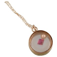 """""""Big Old Doll"""" 14K Gold and Glass Antique Locket Pendant with Garnet and Pearl Enclosed"""