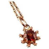 Tiny 14K Gold Garnet Pendant with Star Surround