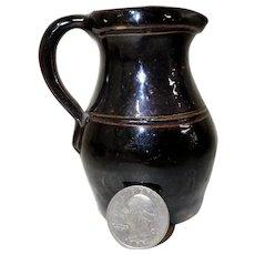 Miniature Stoneware Pitcher w/ Albany Slip Glaze circa 1900