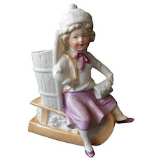 Girl on Sled Antique Ceramic Figurine or Vase--early 1900's