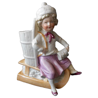 Girl on Sled Antique Ceramic Figurine or Vase