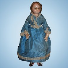 A Rare Charming Wax Over Composition Doll with wax over arms and legs in All Original Silk Costume, 23 1/2 inches