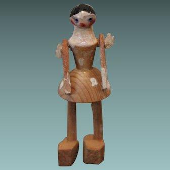 Tiny Wooden Doll