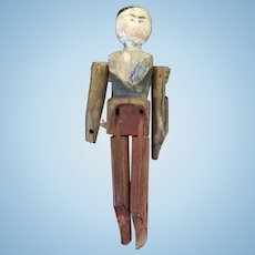 A Delightful Antique Carved Peg Wooden Doll,  3""