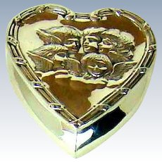 An Antique Silver Heart Shaped Box, Embossed With Cherubs, 1897.