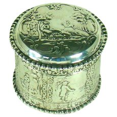 A Circular Dutch Silver Box Embossed With Images Of A Man And His Dog, c1900.