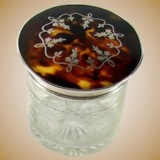 A Sterling Silver And Tortoiseshell Topped Vanity Jar, 1921.