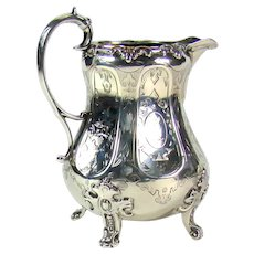 A Victorian Silver Milk Jug, 1870.