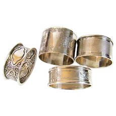 Collection Of Four Sterling Silver Napkin Rings.