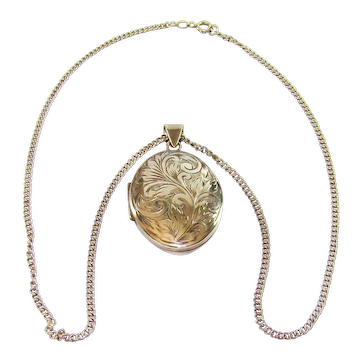 A Lovely Sterling Silver Locket And Silver Chain, 1978.
