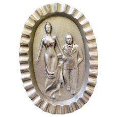 Heavy White Metal Ashtray with Risque Scene, Early to Mid Century