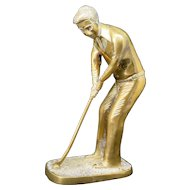 The golf player, brass statue