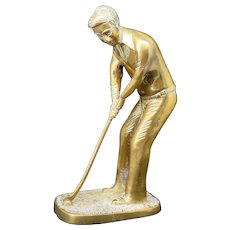 The golf player, brass statue