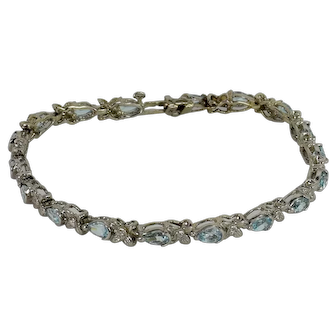 Diamond and Blue Topaz(natural) Tennis Bracelet in 14kt