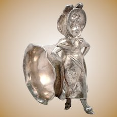 Antique Kate Greenaway Figural Napkin Ring Silverplate Young Lady Arms Akimbo