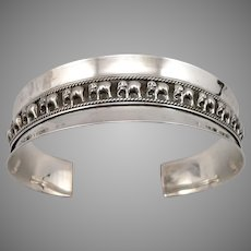 Vintage STERLING Silver ELEPHANT Repousse Wide CUFF BRACELET Line of Pachyderms