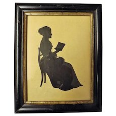 19th Century Silhouette of a Seated Lady Reading a Book