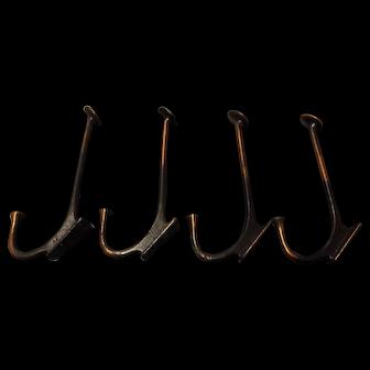A Set of Four 1912 Copper Coat Hooks