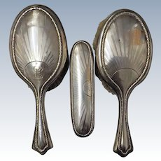 A  Fabulous Set of Three Sterling Silver George V Brushes