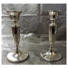 A Pair of Sterling Silver Georgian Revival Candlesticks