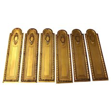 A set of Six 19th Century French Empire Style Gilt Push Plates