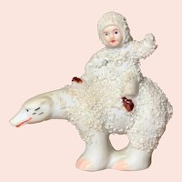 """3"""" tall German All Bisque seated """"Snow Baby"""" on polar bear."""