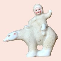 "2 1/2"" tall German all bisque ""Snow Baby"" on polar bear."