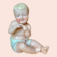 """3 1/2"""" tall German All Bisque seated boy."""