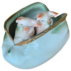 "German glazed porcelain from "" Pink Pig "" series"