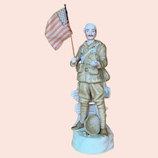 Bisque figure of wounded soldier carrying American flag