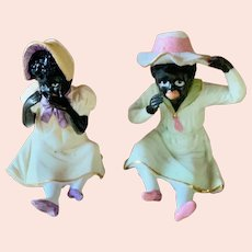 German All Bisque figures of black boy and girl