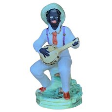 German All Bisque Figurine of black man playing banjo