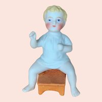 German All Bisque Boy on stool
