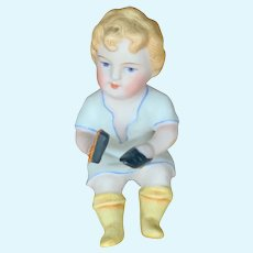 German All Bisque Boy with shoe polish brush