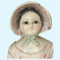 Rare glass eyed wax over papier mache with molded bonnet