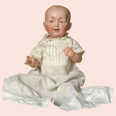 Unusual baby with painted eyes with Kestner-like qualities.