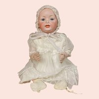 """22 1/2"""" Glass Eyed German character baby incised """"142"""""""