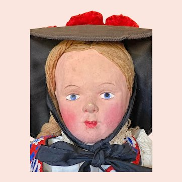 Unusual German Doll with molded and painted papier-mache head