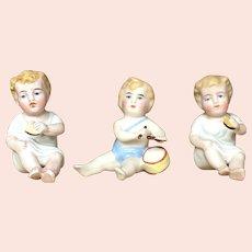 Lot of three German Bisque figurines of children.