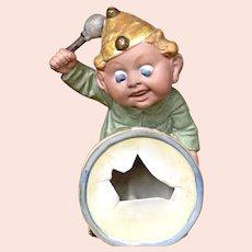Whimsical Schaefer Vater Boy beating drum.