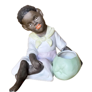 "Charming 41/2"" ( 11 cm ) German figure of young seated black girl"