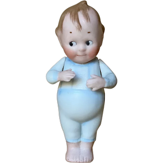 German All Bisque Boy with molded clothing