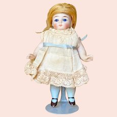 "5 1/2"" ( 13 cm ) German All Bisque doll with Glass eyes and Clothed mouth"