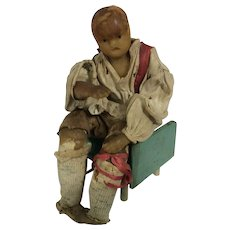 Early wax seated gentleman doll, circa 1830