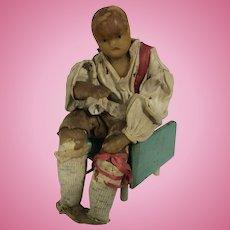Early wax seated gentleman doll, circa 1830